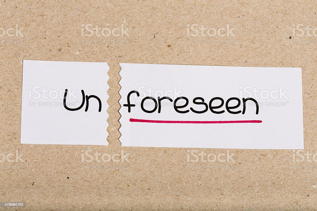 Sign with word unforeseen turned into foreseen stock photo