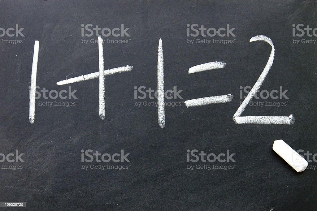 1+1=2 sign written with chalk on blackboard stock photo