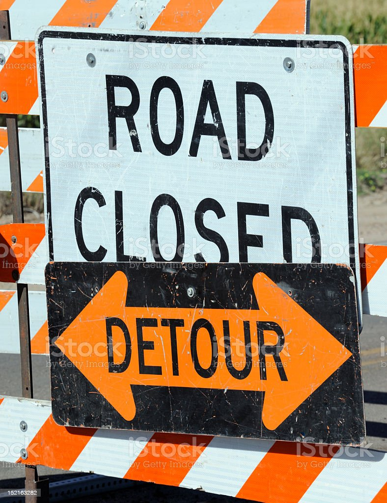 A signage of road closure suggesting detour stock photo