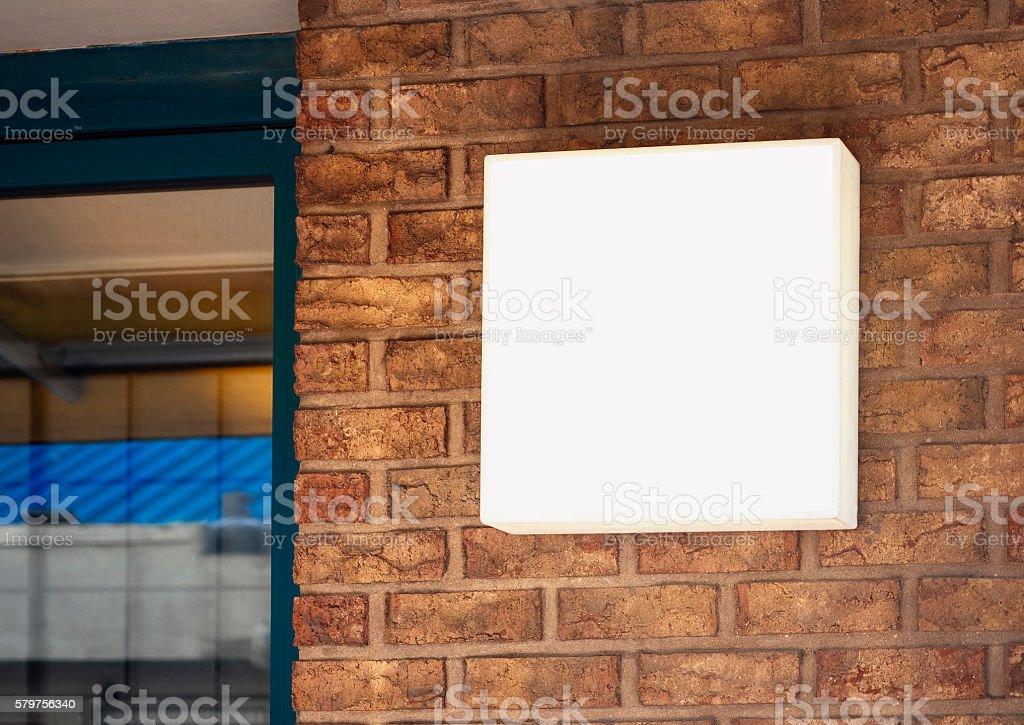 Signage Shop Mock up Sign display on brick wall stock photo