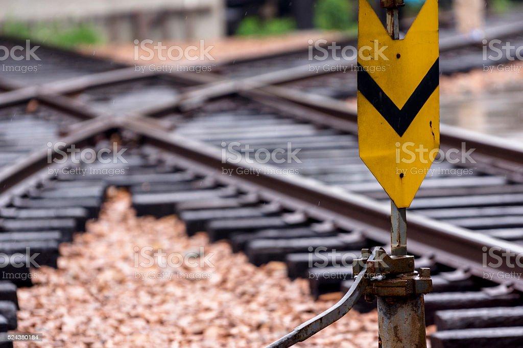 signal light beside railway track stock photo