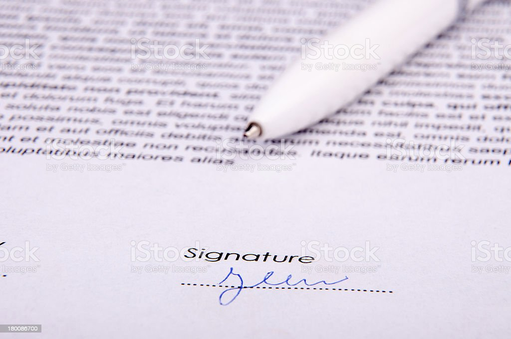 Signature over agreement royalty-free stock photo