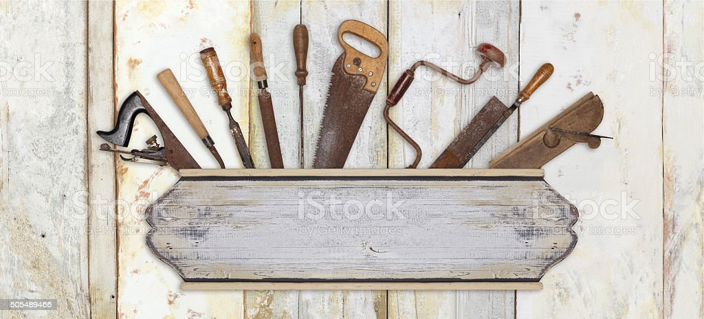 signboard and carpenter tools on wooden background stock photo