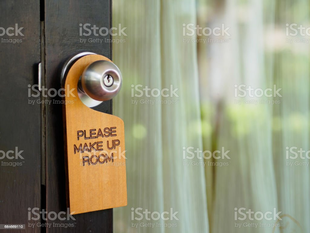 Signboard make up room hanging on open door in a hotel stock photo