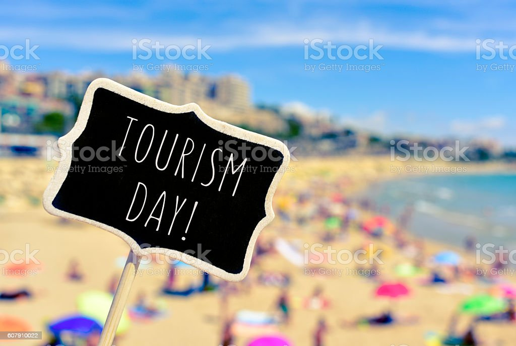 signboard with the text tourism day stock photo