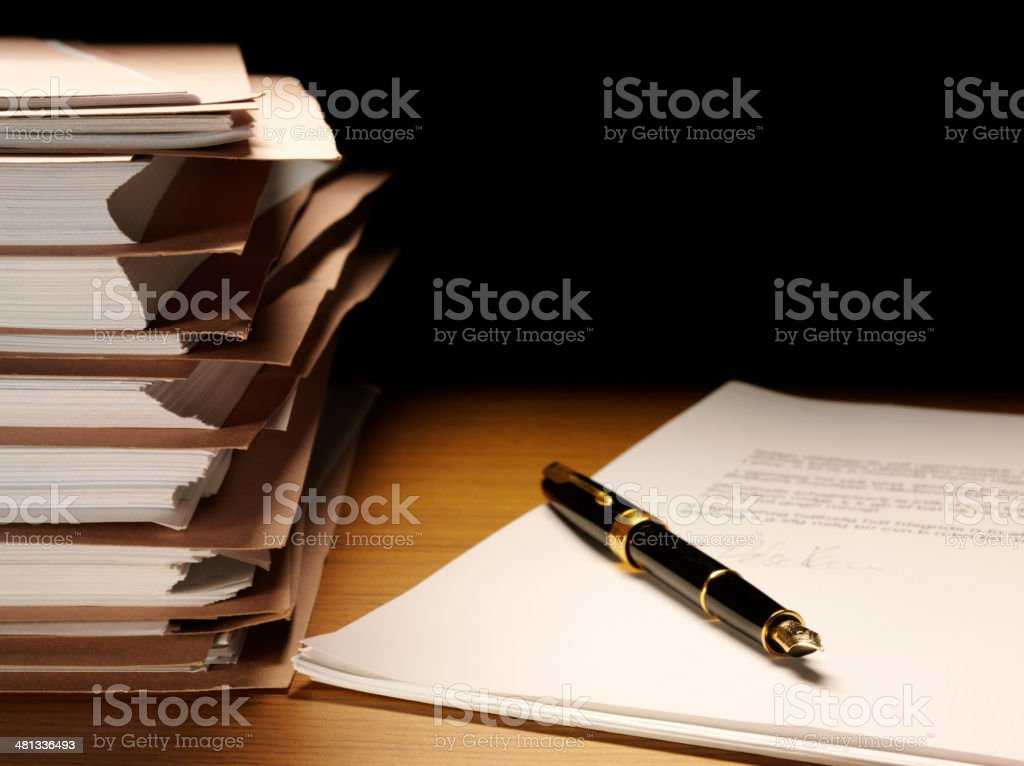 Signed Document with an Ink Pen and Paper Files stock photo
