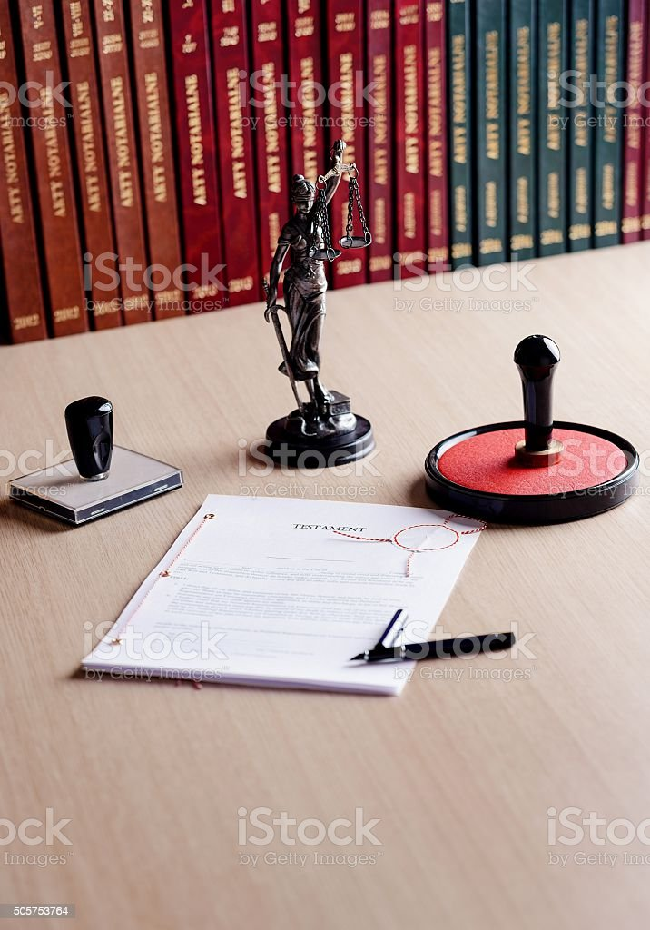 Signed last will on notary public desk. stock photo