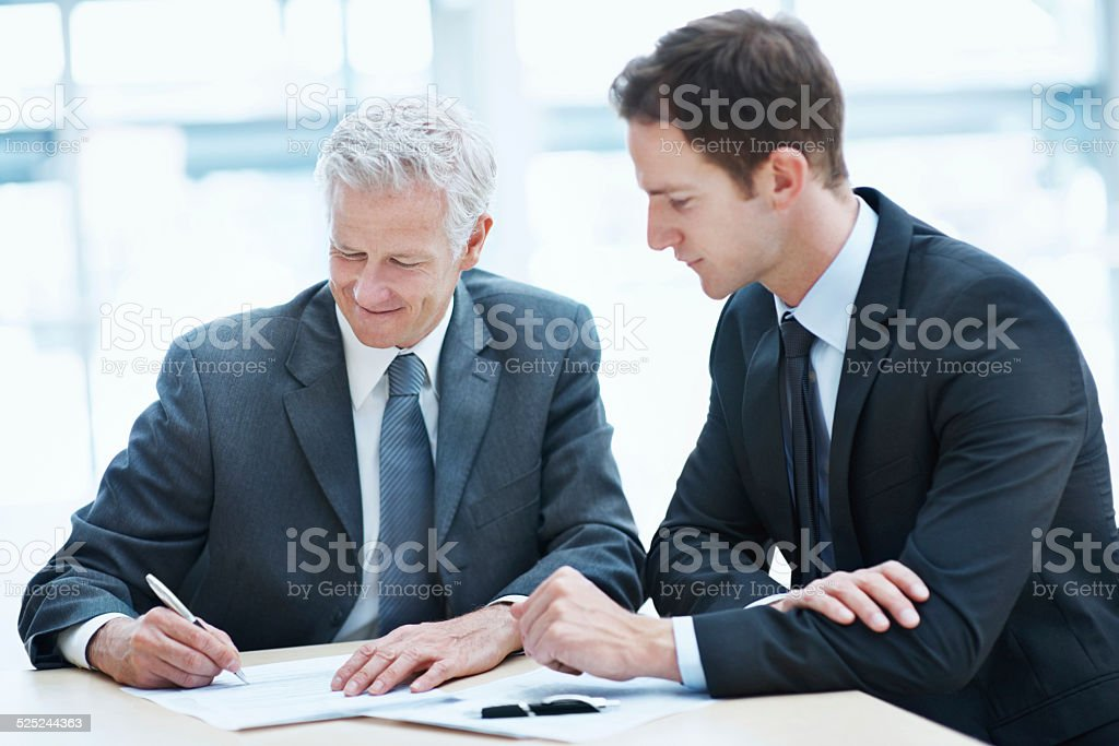 Signed on for success stock photo