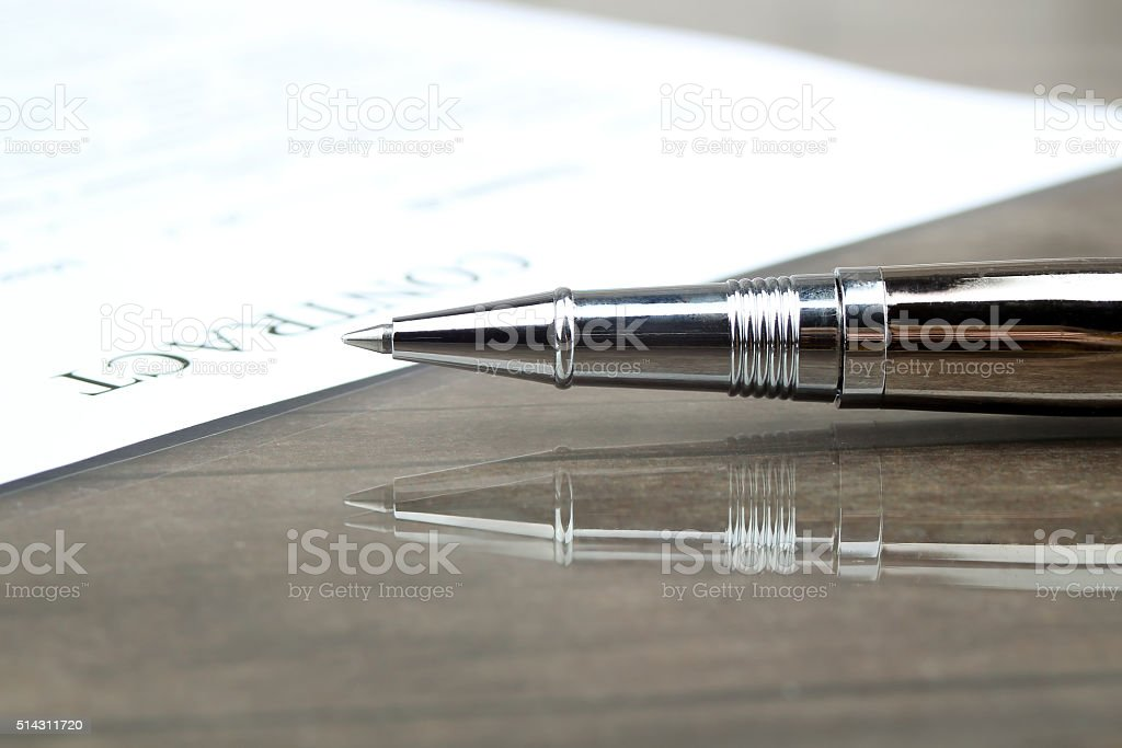 signing a contract, business contract details stock photo