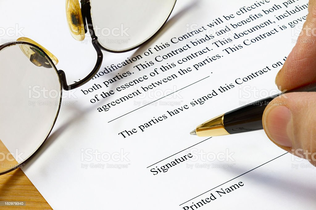Signing A Contract Form royalty-free stock photo