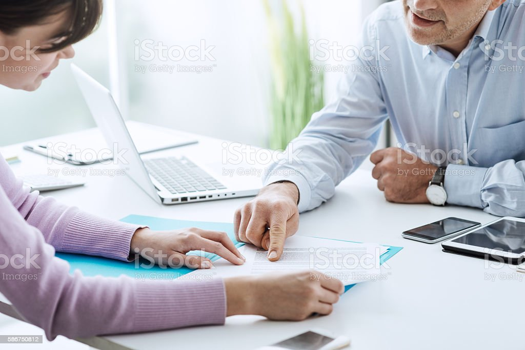 Signing a contract stock photo