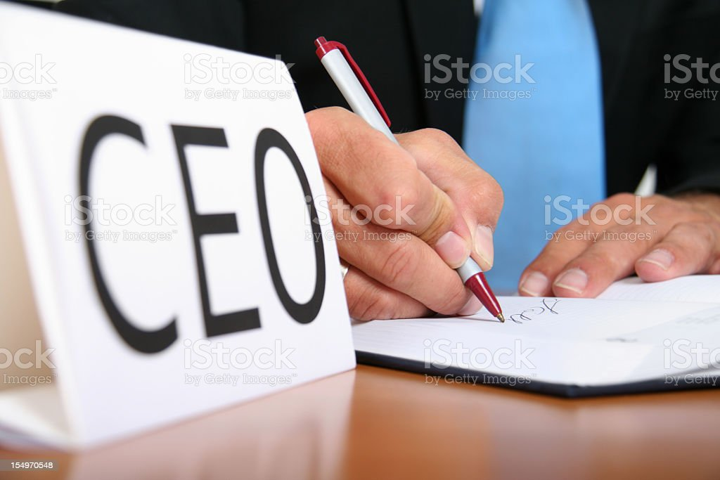 CEO signing a document on his table royalty-free stock photo