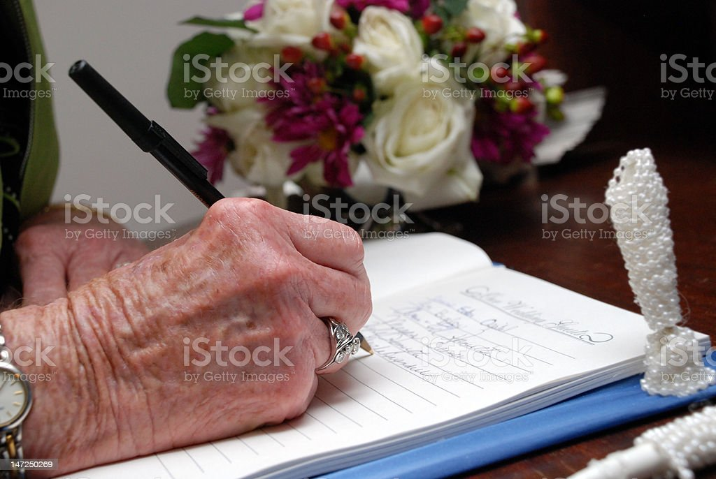 signing a guestbook royalty-free stock photo