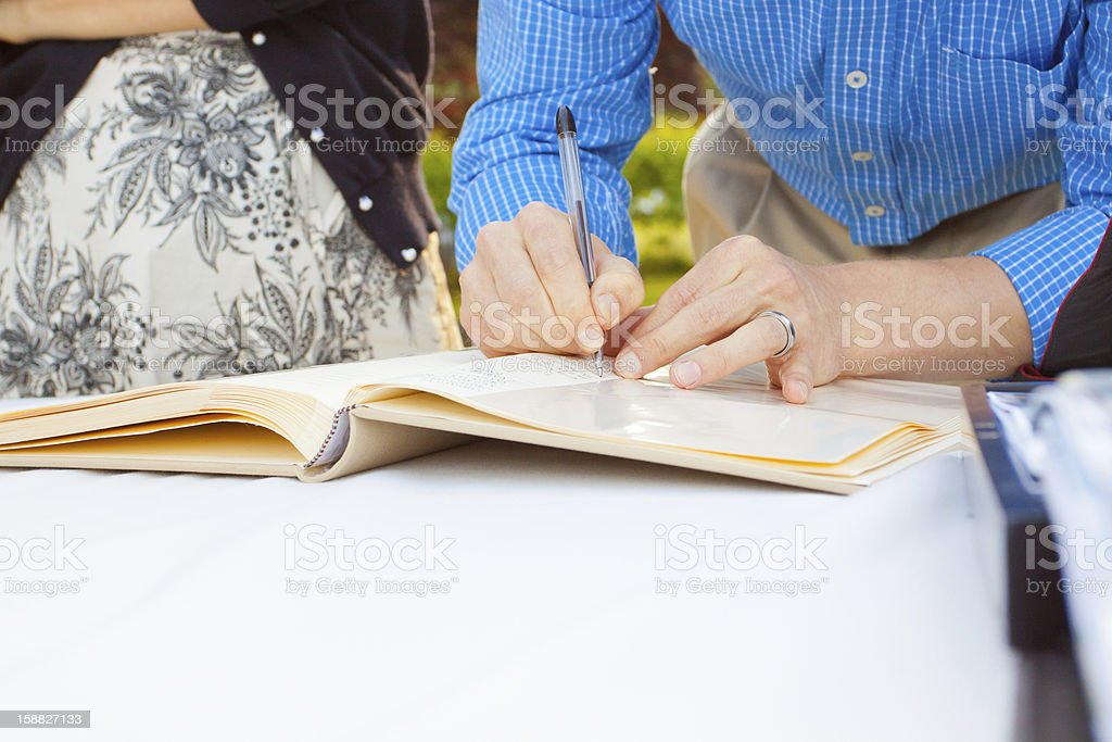 Signing a Guestbook stock photo