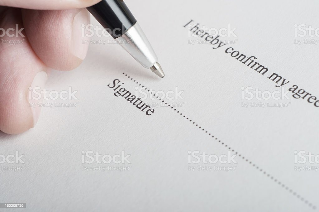 Signing a Legal Document stock photo