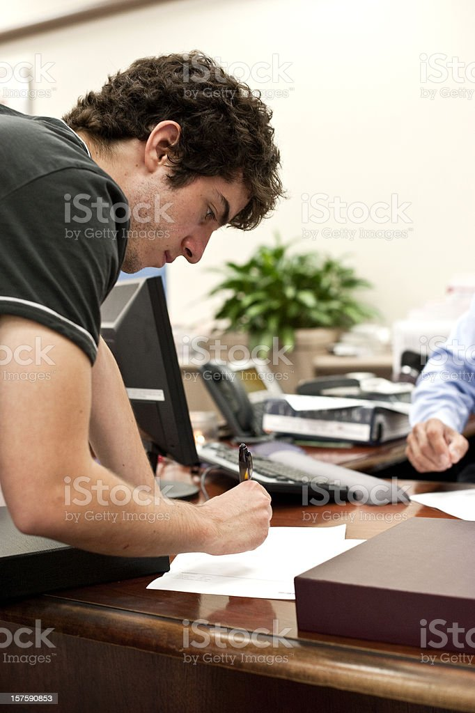 Signing a loan agreement royalty-free stock photo