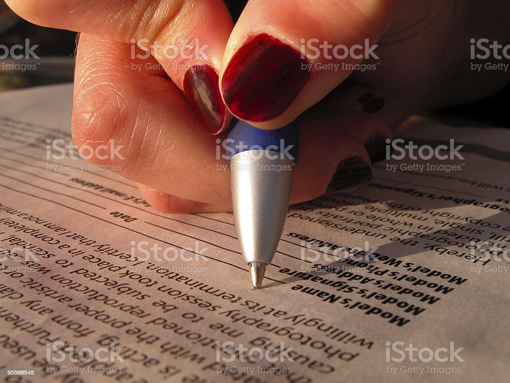 Signing a model release royalty-free stock photo