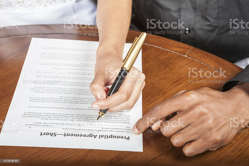 Signing a prenuptial agreement stock photo