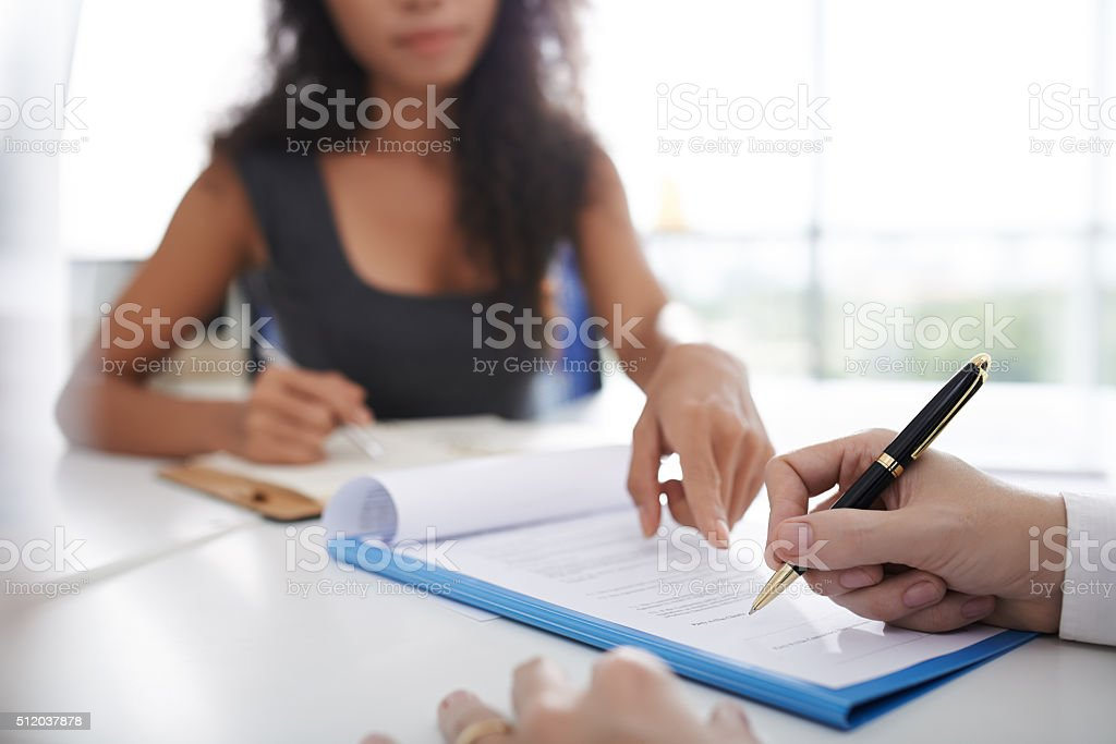 Signing agreement stock photo