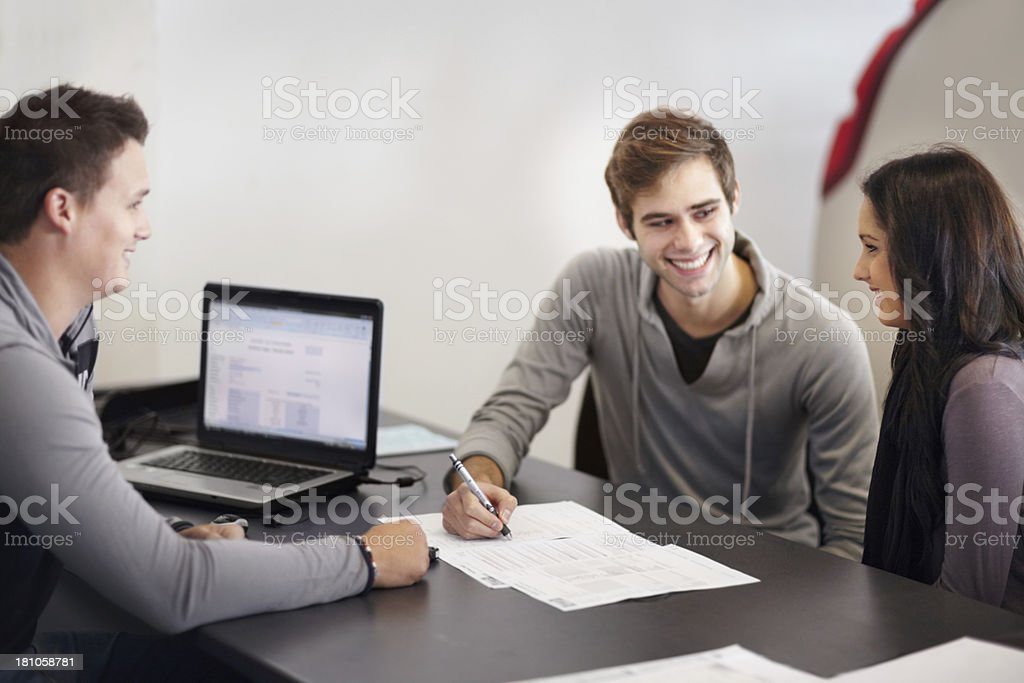 Signing all the paperwork stock photo