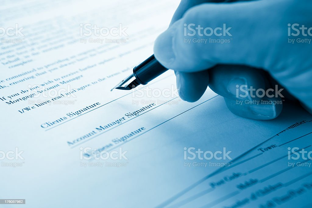 Signing an application form royalty-free stock photo