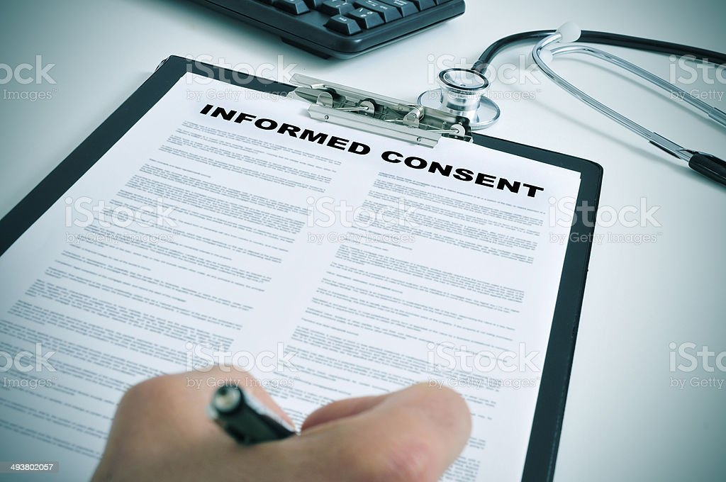 signing an informed consent stock photo