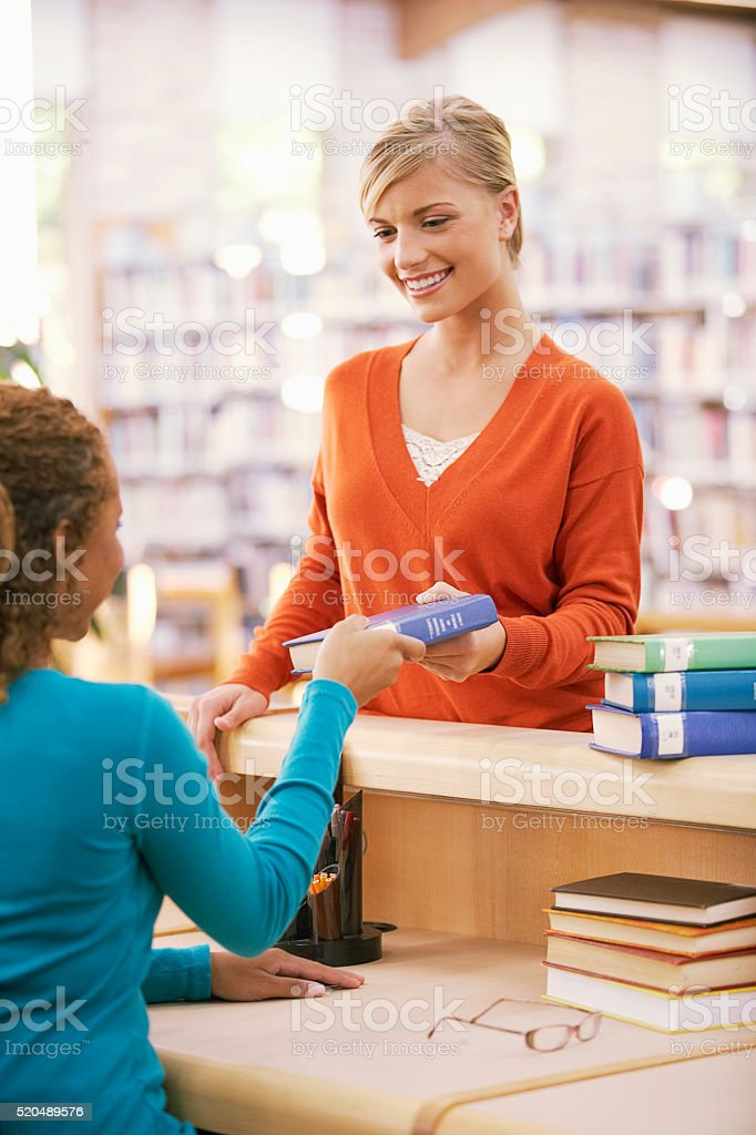 Signing books out of the library stock photo