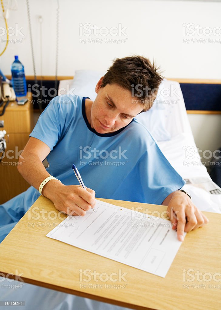 Signing consent for surgery stock photo