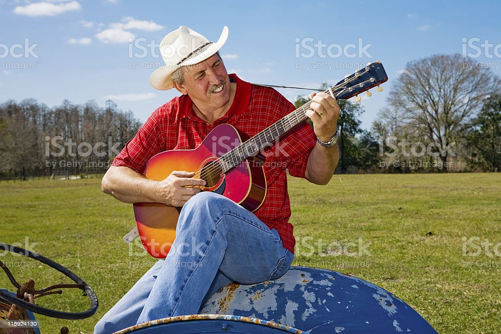 Signing Cowboy on Tractor royalty-free stock photo