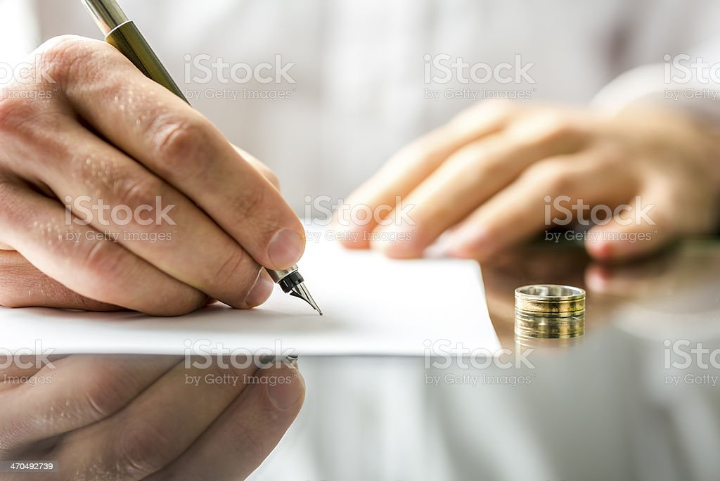 Signing  divorce papers royalty-free stock photo