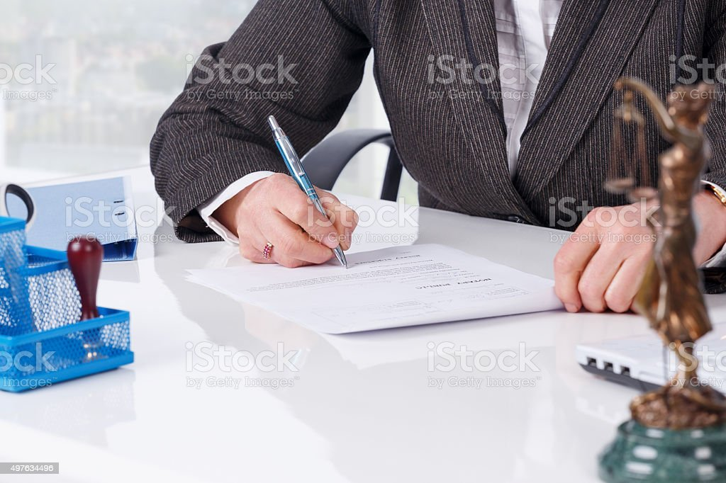 Signing document at office stock photo