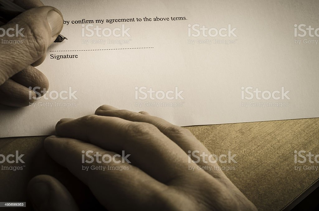 Signing Document - Austere Light stock photo