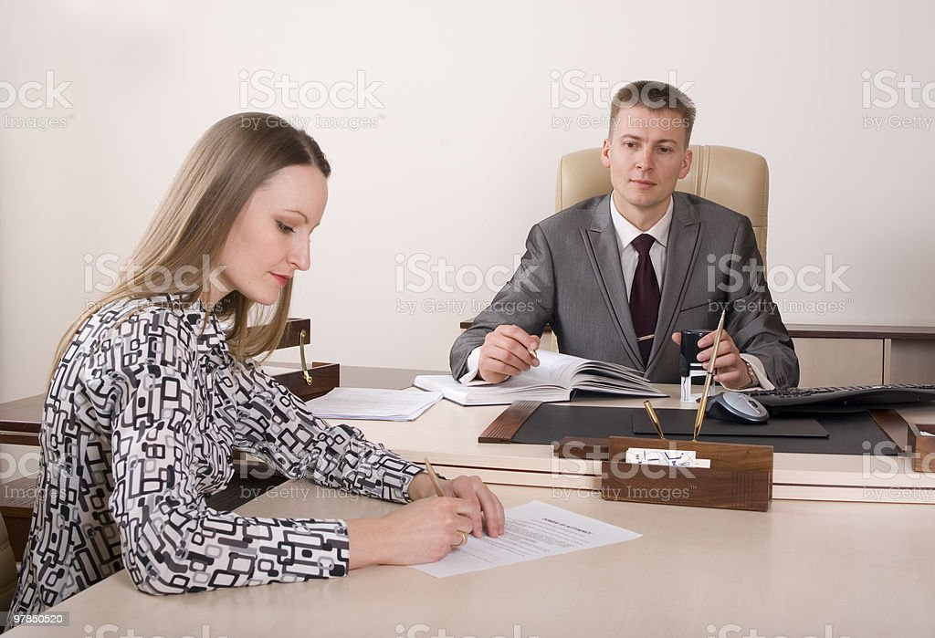 Signing documents at the notary royalty-free stock photo