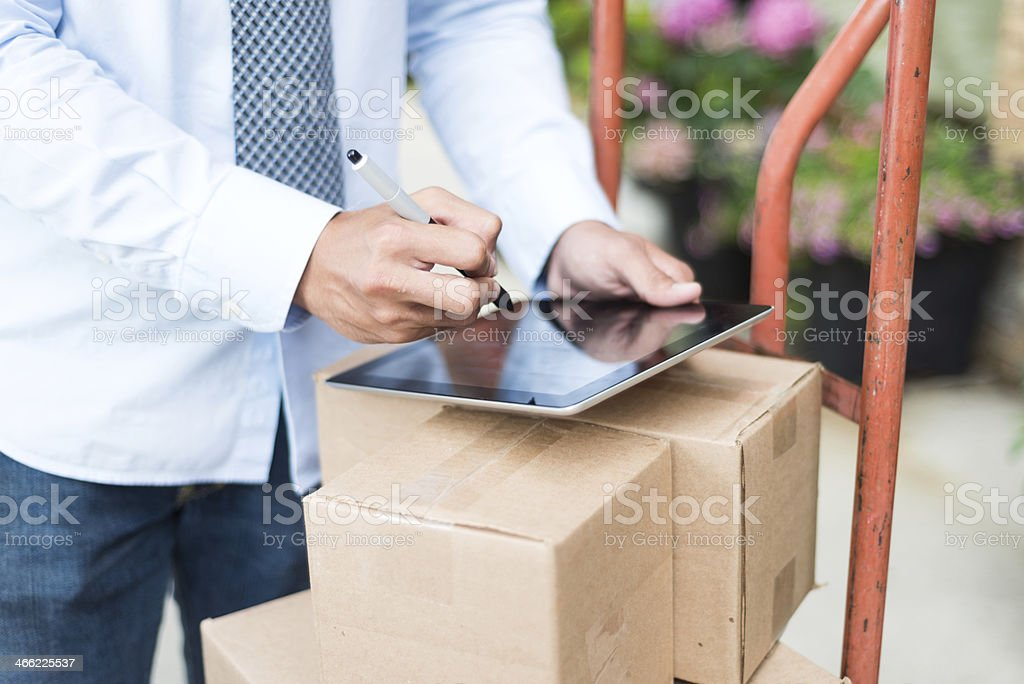 Signing for Package stock photo