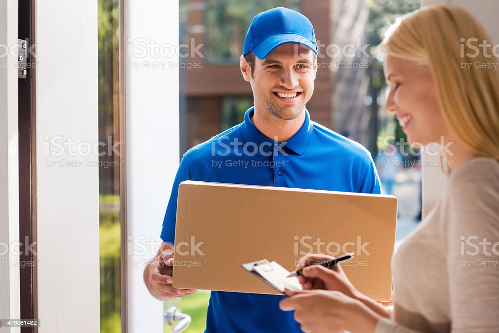 Signing for the package. stock photo