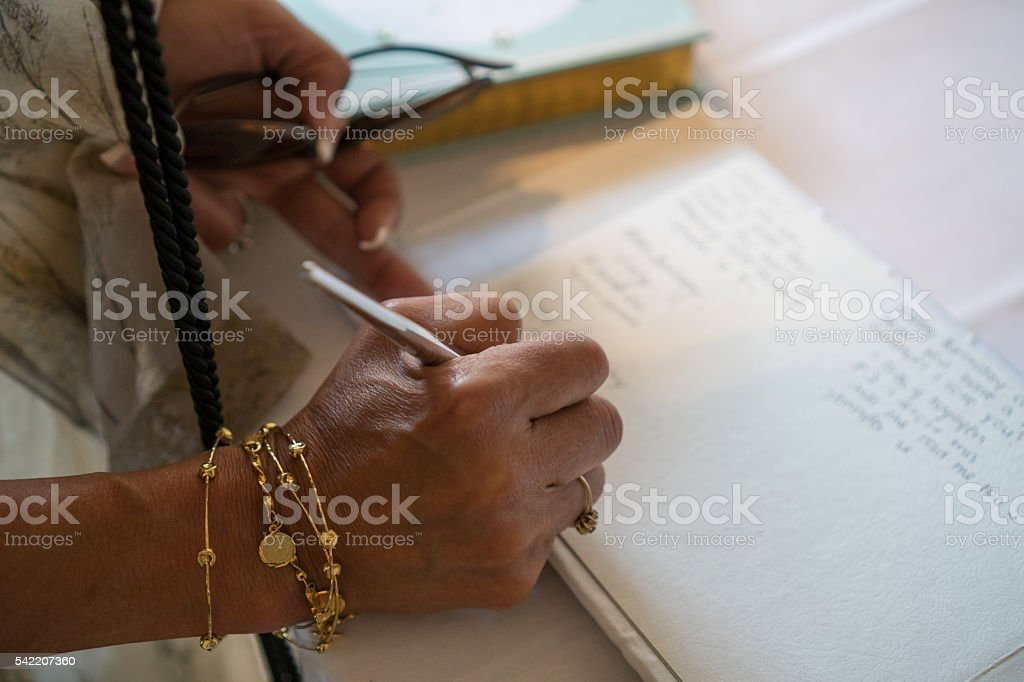 Signing guest book stock photo