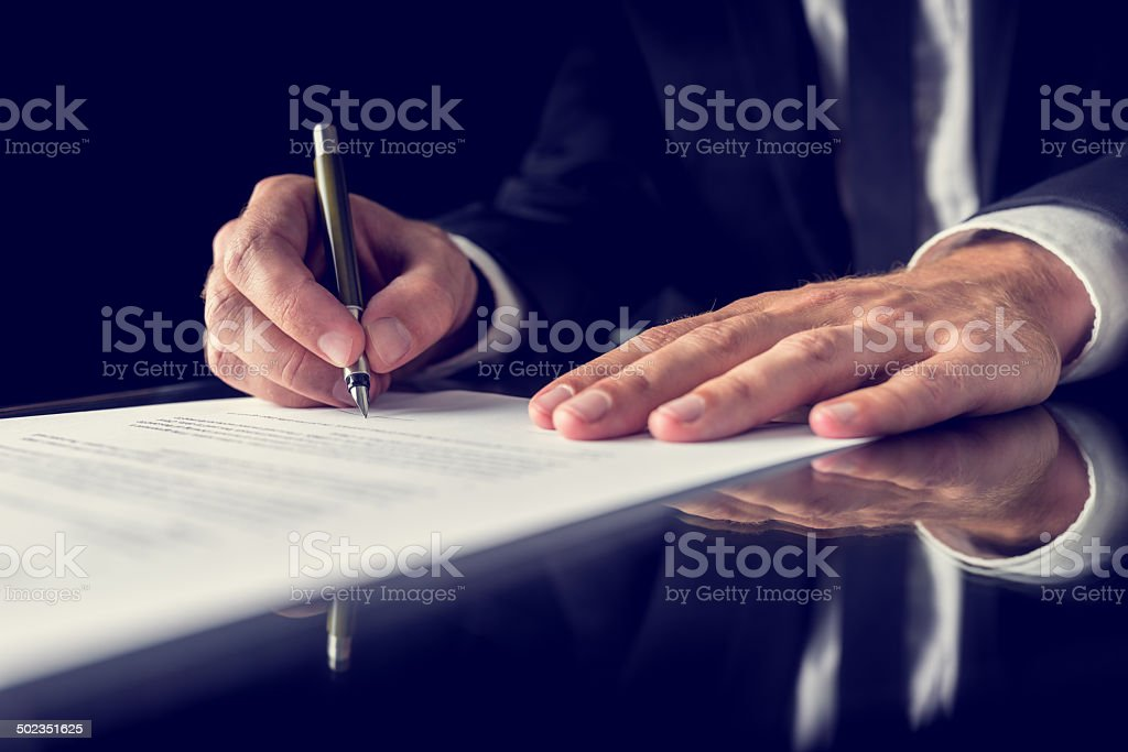 Signing legal document stock photo