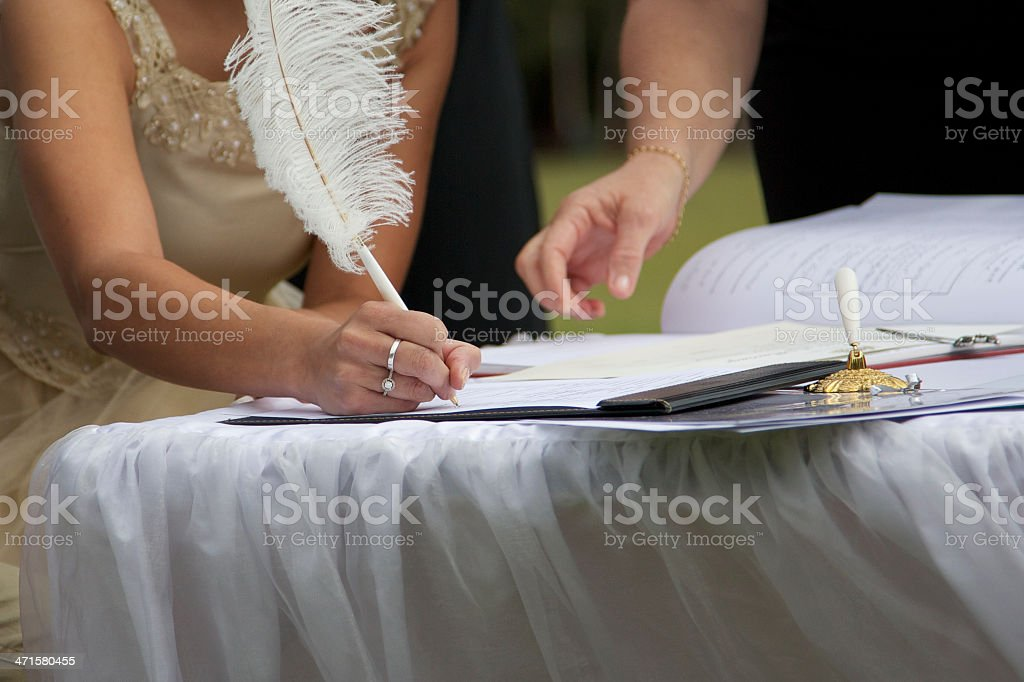 Signing of marriage certificate royalty-free stock photo