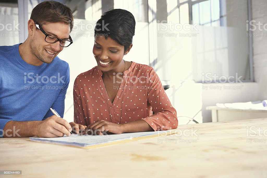 Signing off on the business report stock photo
