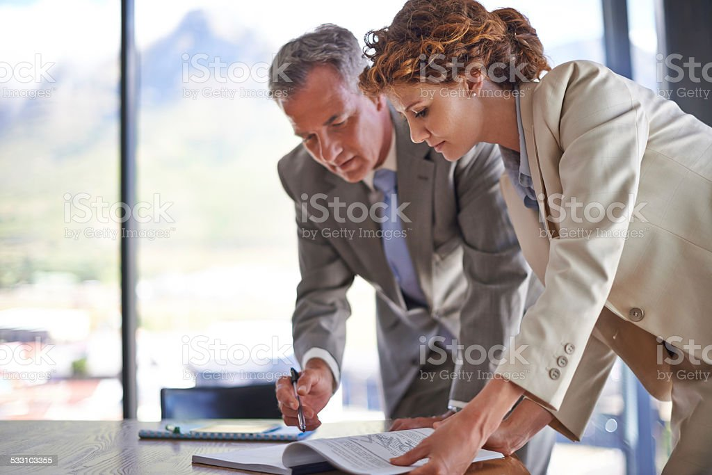 Signing off on the final draft stock photo