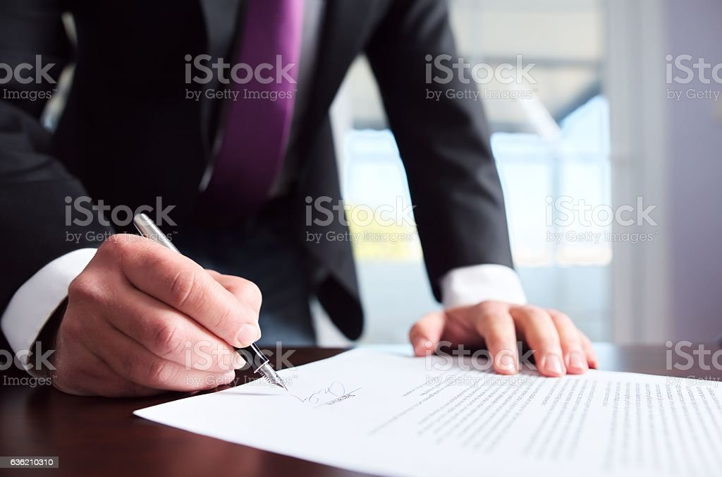 Signing Official Document stock photo