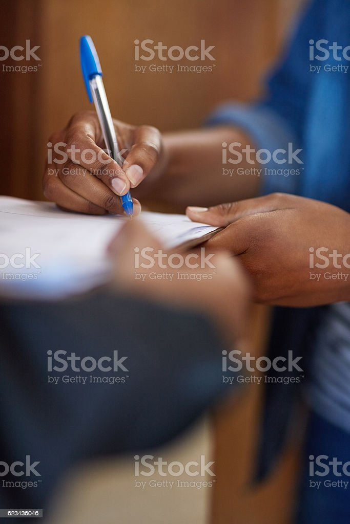 Signing on the dotted line stock photo