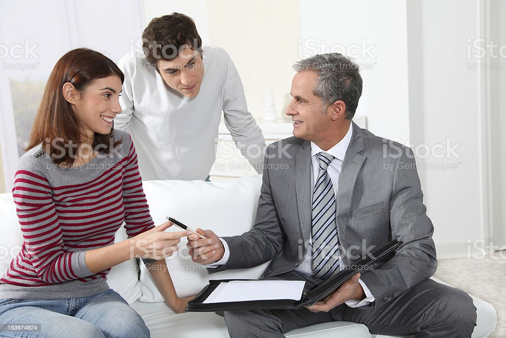 Signing property contract royalty-free stock photo