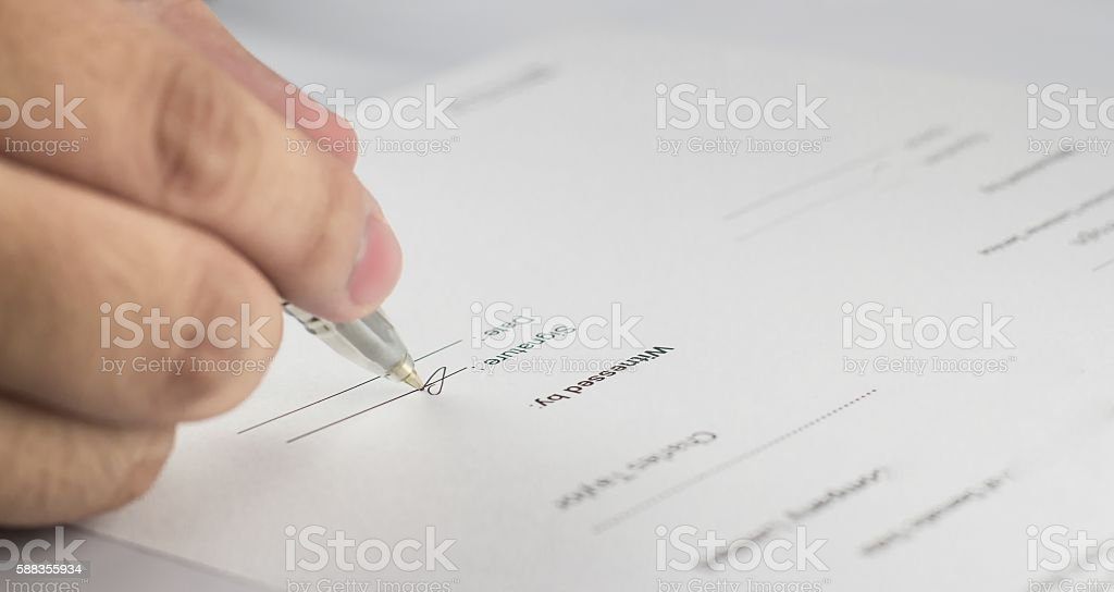 Signing the contract in business work stock photo