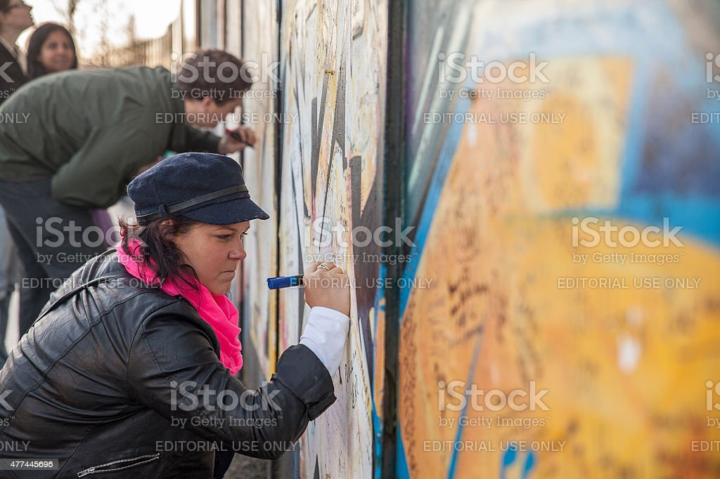 Signing the peace wall in Northern Ireland stock photo