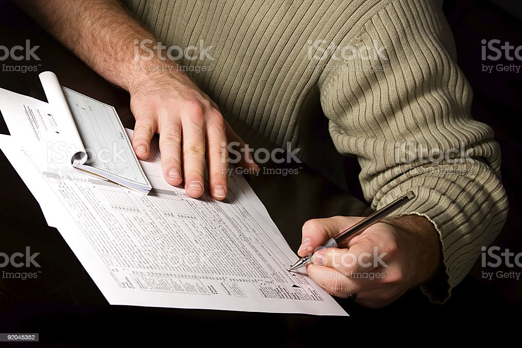 Signing the Tax Forms royalty-free stock photo