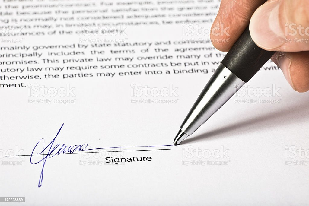 signing up a contract agreement royalty-free stock photo