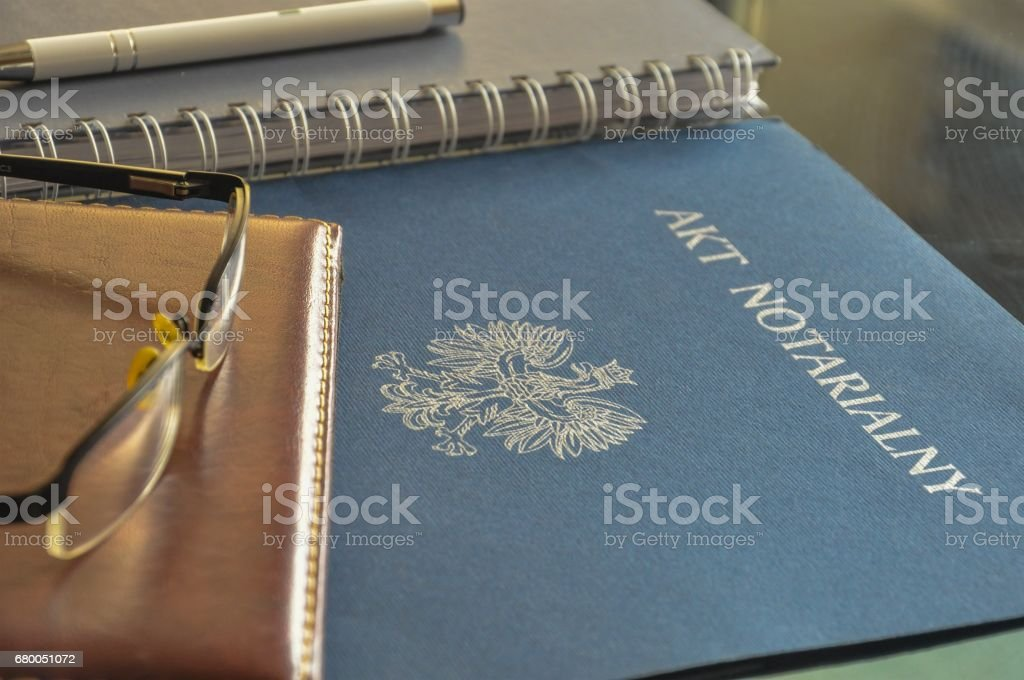 Signing up notarial act. 'Akt notarialny' means 'notarial act'. stock photo
