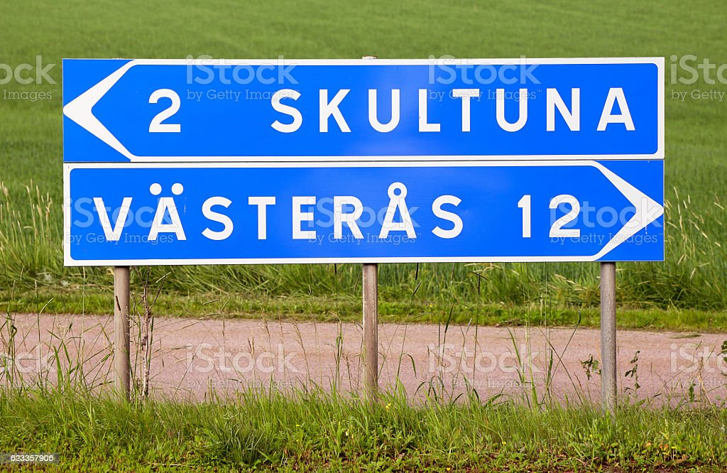 Signpost for Skultuna and Vasteras stock photo