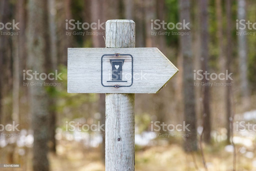 WC signpost in forest stock photo